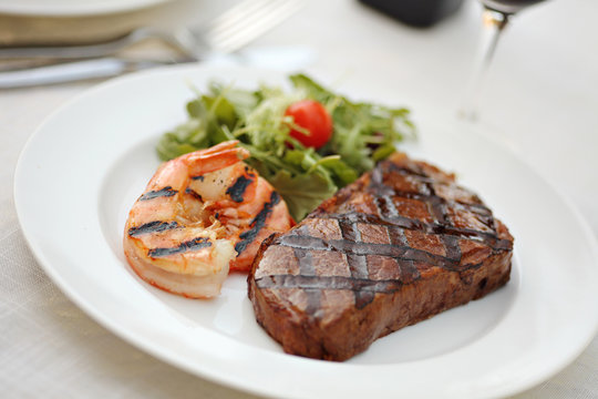 Grilled sirloin steak and shrimps