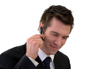 Young businessman smiling with a headset