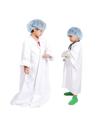 Two very cute children in white hospital clothes