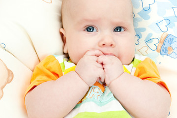 Infant with hands in mouth
