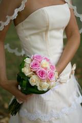 bride holding rose wedding bouquet