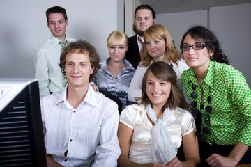 Young group of people smiling while watching at the screen