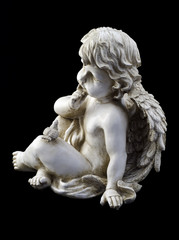Small angel with a dove