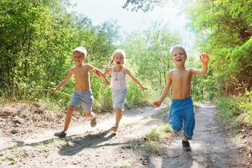 happy kids running in the woods