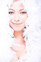 smiling young woman with white downy boa over her head