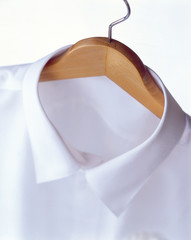 A white shirt on a hanger