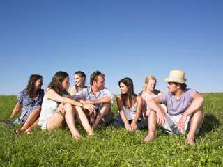 Group sitting in meadow