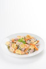 Plate of shrimp fried rice peas ham omelette
