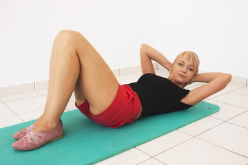 Young blond woman workout in gym