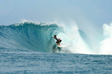 Surfer in the barrel, Mentawai Islands, Indonesia