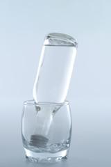 bottle inside glass
