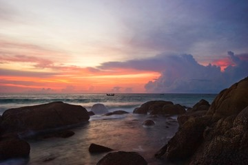 Tropical sunset on the rocks