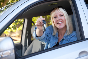 Attractive Woman In New Car with Keys
