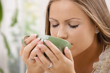 Beautiful girl drinking tea