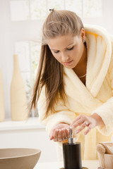 Young woman washing hands