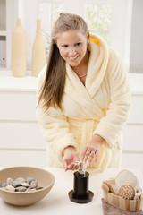 Young woman washing hands