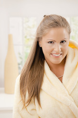 Young woman in bathrobe