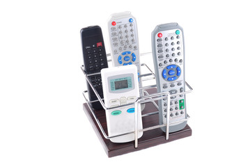 Support under mobile phones and remote controls