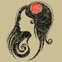 Decorative grunge portrait of woman with flower in the hair