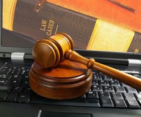 judges court gavel on a laptop computer (cyber law)