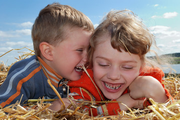 laughing Boy and girl outdoors