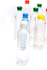 Plastic bottles of mineral water isolated on white background