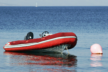 RIB, rigid inflatable boat moored at buoy
