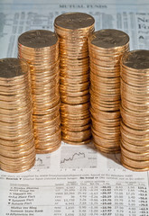 Stacks of  dollar gold coins on investment section of Journal