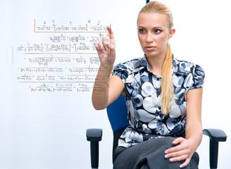 woman solving math formula