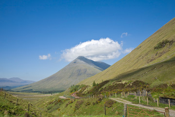 Mountain Beinn Dorain, Scotland, Highlands, with a cloud over it