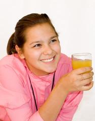 Portrait of girl. The girl drinks orange juice.