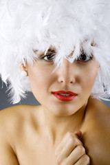 attractive woman wearing a white feather wig