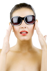 woman holding her sunglasses