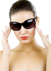 young woman in big black fashion sunglasses