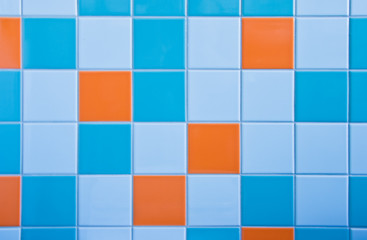 Tiles on wall in light blue, azure blue and orange