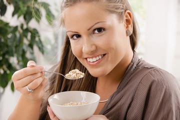 Young woman eating muesli