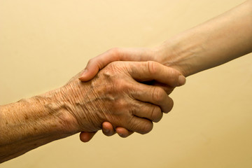 hand of old and young woman