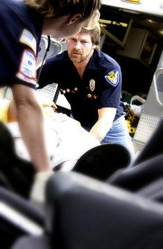 EMTs helping victim from car crash