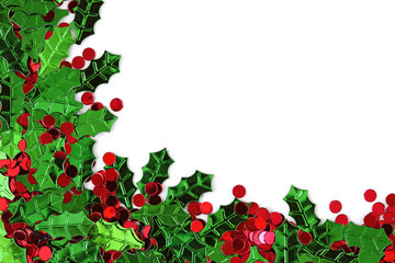Holly berry confetti on white background