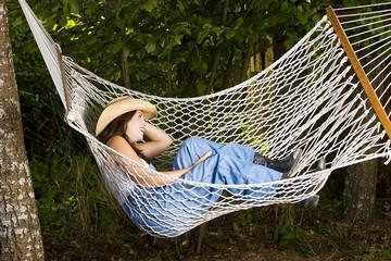 Healthy woman resting in Hammock