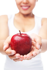 Woman holding a red apple