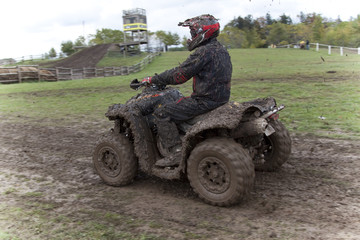 Muddy ATV and rider