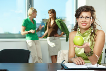 Businesswoman holding apple