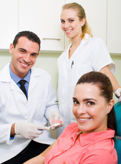 dentist and assistant demorstrate tooth brush