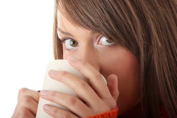Teen woman with cup of coffee