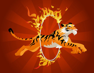 Tiger jumping through a hoop of fire.
