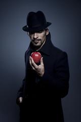 Mysterious man holding an apple ....