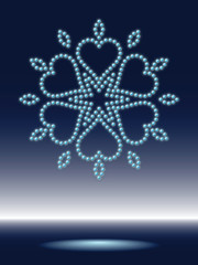 shiny snowflake made from sparkling water-drops
