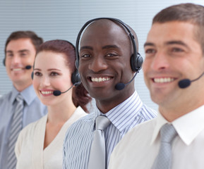 Afro-American businessman working in a call center in a line
