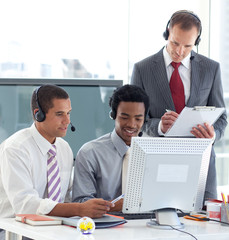 Manager and businessmen working in call center